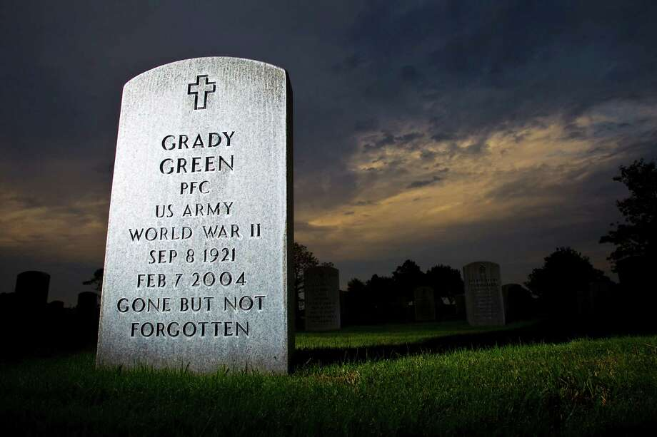 The grave of Grady Green, World War II veteran, buried at Houston National Cemetery, Tuesday, May 15, 2012, in Houston. Green had his money stolen by a Houston woman who was supposed to be his caregiver - she got $5,000 to buy him a grave and pay for his care, but instead blew it on her own bills, traffic tickets and plumbing repairs. He died before the VA investigated the case. (Karen Warren / Houston Chronicle ) Photo: Karen Warren / © 2012  Houston Chronicle