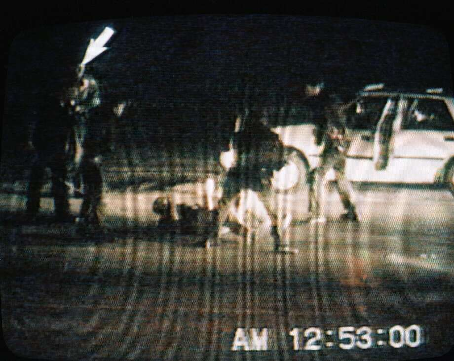 This picture taken from a CBS Television broadcast on March 15, 1991, shows the March 3, 1991, incident in Los Angeles in which Rodney King (on ground) was beaten by police officers.  Photo: CBS, AFP/Getty Images