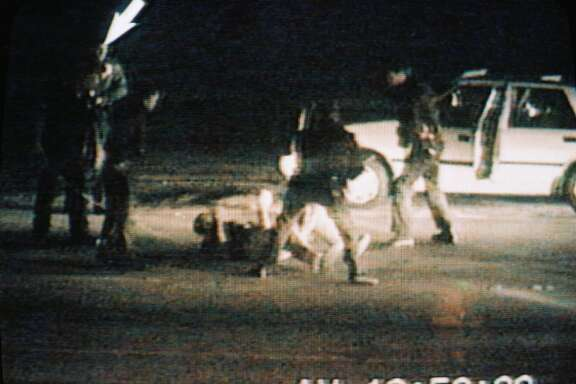 "(FILES) Picture taken from a CBS Television broadcast March 15, 1991, showing the March 3, 1991 incident in Los Angeles in which Rodney King (on ground) was beaten by police officers. King was found dead in his swimming pool in Rialto, California, on June 17, 2012, according to media reports. King's beating by police sparked the 1992 Los Angeles riots that left more than 50 people dead.      AFP PHOTO/CBS/HO     ++RESTRICTED TO EDITORIAL USE - MANDATORY CREDIT "" AFP PHOTO / CBS "" - NO MARKETING NO ADVERTISING CAMPAIGNS - DISTRIBUTED AS A SERVICE TO CLIENTS++-/AFP/GettyImages"