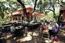 Shade from tall trees cool the outdoor patio at La Hacienda de los Barrios. It has repeated as winner of the Readers' Choice for best outdoor dining.