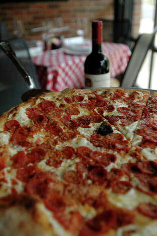 Grimaldis Pizzeria, 330 E Basse Rd, Suite 101, at The Quarry Village, 210-832-8288 Photo: San Antonio Express-News File Photo / SAN ANTONIO EXPRESS-NEWS