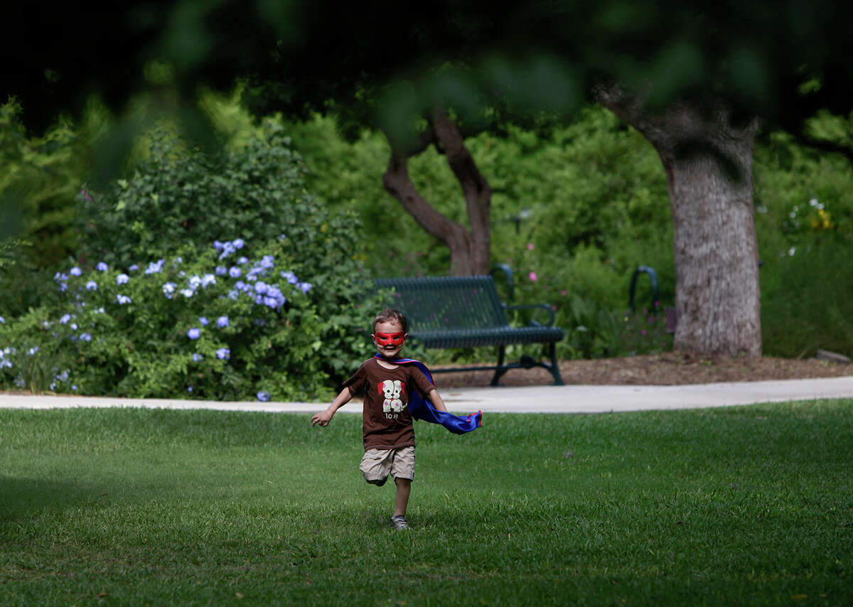 Lucas Rodriguez, 3, runs through Landa Gardens on the grounds of the Landa Branch of the San Antonio Public Library in San Antonio on Friday, June 1, 2012. Rodriguez regularly wears his cape and mask and portrays various super heroes.