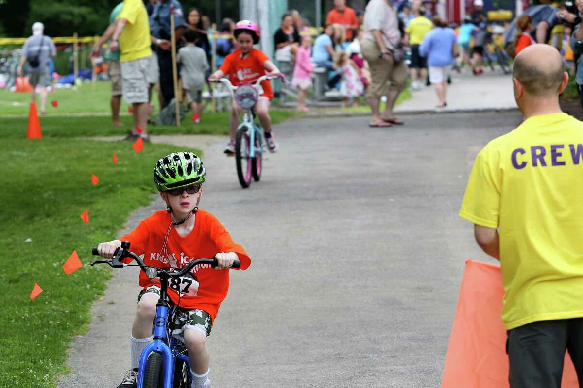 Mike Ross Connecticut Post freelance -Max Katchko age 7 rides in the third annual Kids Triathlon Stamford Jewish Community Center on Father's day.