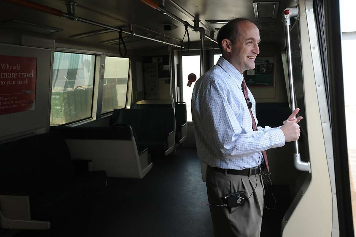 Bob Franklin, President of the Board of Directors, talks to the media in a BART train during a media availability at the BART Hayward Maintenance Complex in March 2011.