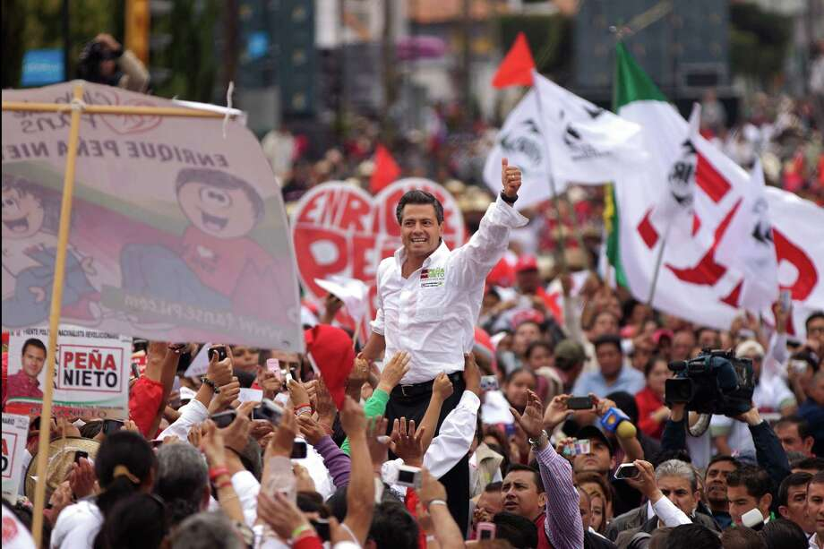 Enrique Pena Nieto, waving to supporters during Sunday's campaign rally in Altacomulco, Mexico, is running for president on the Institutional Revolutionary Party (PRI) ticket. Photo: AP