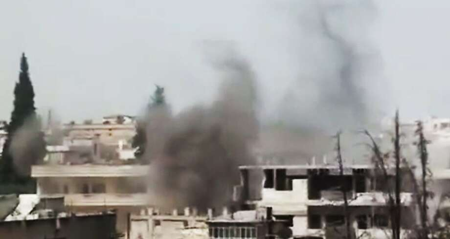 This image made from amateur video released by Ugarit News and accessed Sunday, June 17, 2012, purports to show black smoke rising from buildings in Rastan town, in Homs province, Syria. Activists say Syrian troops have intensified their shelling of rebel-held neighborhoods in the central city of Homs as living conditions there deteriorate further. (AP Photo/Ugarit News via AP video) TV OUT, THE ASSOCIATED PRESS CANNOT INDEPENDENTLY VERIFY THE CONTENT, DATE, LOCATION OR AUTHENTICITY OF THIS MATERIAL Photo: Anonymous, Associated Press