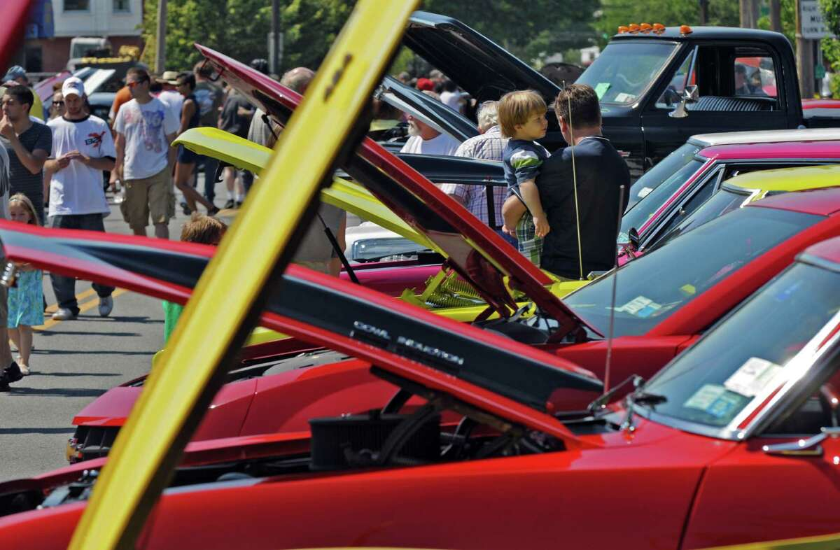 James Thiessen of Schenectady and his son Lucas, 2, inspect some of the 240 vehicles on display on Mohawk Avenue during the annual Cruisin' on the Avenue car show on Sunday June 17, 2012 in Scotia, NY. (Philip Kamrass / Times Union)