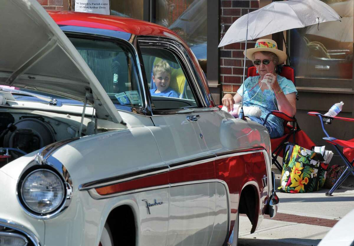 Pam Dodds of Rotterdam knits while sitting with her husband Duane and his 1955 DeSoto, one of the 240 vehiclels on display on Mohawk Avenue during the annual Cruisin' on the Avenue car show on Sunday June 17, 2012 in Scotia, NY. (Philip Kamrass / Times Union)