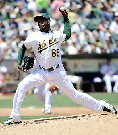 OAKLAND, CA - JUNE 17:  Pedro Figueroa #65 of the Oakland Athletics pitches in the fouth inning against the San Diego Padres at O.co Coliseum on June 17, 2012 in Oakland, California. Figueroa came in to pitch after starting pitcher Bartolo Colon left the game with an injury.  (Photo by Thearon W. Henderson/Getty Images) Photo: Thearon W. Henderson, Getty Images