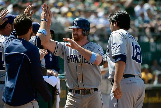 OAKLAND, CA - JUNE 17:  Logan Forsythe #11 of the San Diego Padres is congratulated by teammates after scoring from third on a wild pitch by Ryan Cook #48 of the Oakland Athletics in the ninth inning at O.co Coliseum on June 17, 2012 in Oakland, California.  (Photo by Thearon W. Henderson/Getty Images) Photo: Thearon W. Henderson, Getty Images