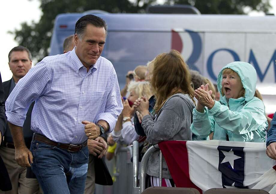 Republican presidential candidate, former Massachusetts Gov. Mitt Romney arrives for a campaign stop at Mapleside Farms on Sunday, June 17, 2012 in Brunswick, Ohio.  (AP Photo/Evan Vucci) Photo: Evan Vucci, Associated Press