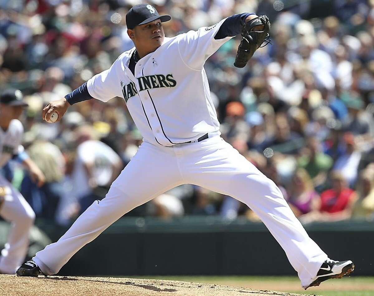 SEATTLE, WA - JUNE 17: Starting pitcher Felix Hernandez #34 of the Seattle Mariners pitches against the San Francisco Giants during an interleague game at Safeco Field on June 17, 2012 in Seattle, Washington. (Photo by Otto Greule Jr/Getty Images)