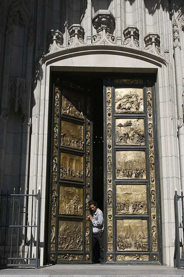 A replica of an eight-ton gilded bronze door at Grace Cathedral being opened by lead sexton Moises Gonzalez in San Francisco, California, on Wednesday, June 13, 2012. Photo: Liz Hafalia, The Chronicle