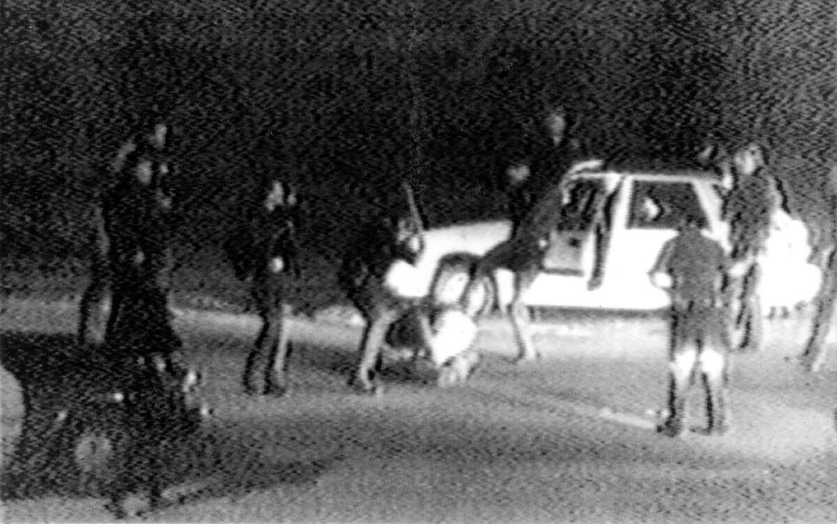 This March 3, 1991, image made from video provided by KTLA Los Angeles shows police officers beating Rodney King. The beating was the touchstone for one of the most destructive race riots in the nation's history. (AP Photo/Courtesy of KTLA Los Angeles, George Holliday)