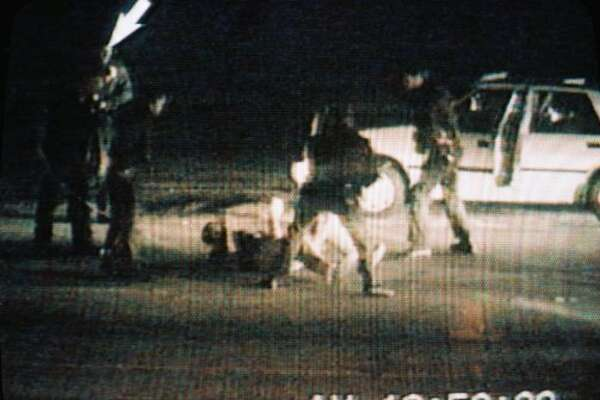 Picture taken from a CBS Television broadcast March 15, 1991, showing the March 3, 1991 incident in Los Angeles in which Rodney King (on ground) was beaten by police officers. King was found dead in his swimming pool in Rialto, California, on June 17, 2012, according to media reports. King's beating by police sparked the 1992 Los Angeles riots that left more than 50 people dead.   (- / AFP/Getty Images)