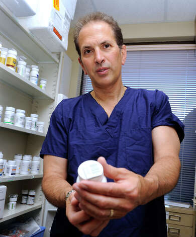 Jim Cangelosi of Southbury, a pharmacist and owner of Brookfield Pharmacy, is photographed Friday, June 14, 2012. Photo: Carol Kaliff / The News-Times