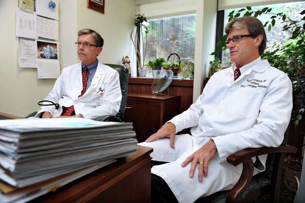 Dr. Robert Kloss, left, chief of hematology and oncologist at Danbury Hospital and Dr. Patrick Broderick, chairman of Emergency Medicine, talk about medical marijuana Thursday, June 14, 2012. Photo: Carol Kaliff / The News-Times