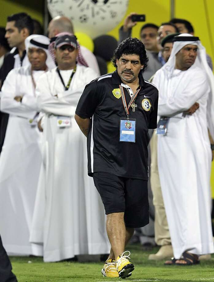 Argentinian coach of Al Wasl, Diego Maradona, center, reacts during a  match with Al Muharraq club from Bahrain during the final match of GCC Champions League in Dubai , United Arab Emirates, Sunday, June 10, 2012. (AP Photo/Kamran Jebreili) Photo: Kamran Jebreili, Associated Press