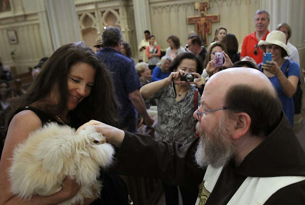 Father Gregory Coiro blesses Starbucks, Kathleen Hewtson's angora bunny, at the annual Blessing of the Animals at The Shrine of Saint Francis of Assisi during the North Beach Festival in San Francisco, Calif., Sunday, June 17, 2012.