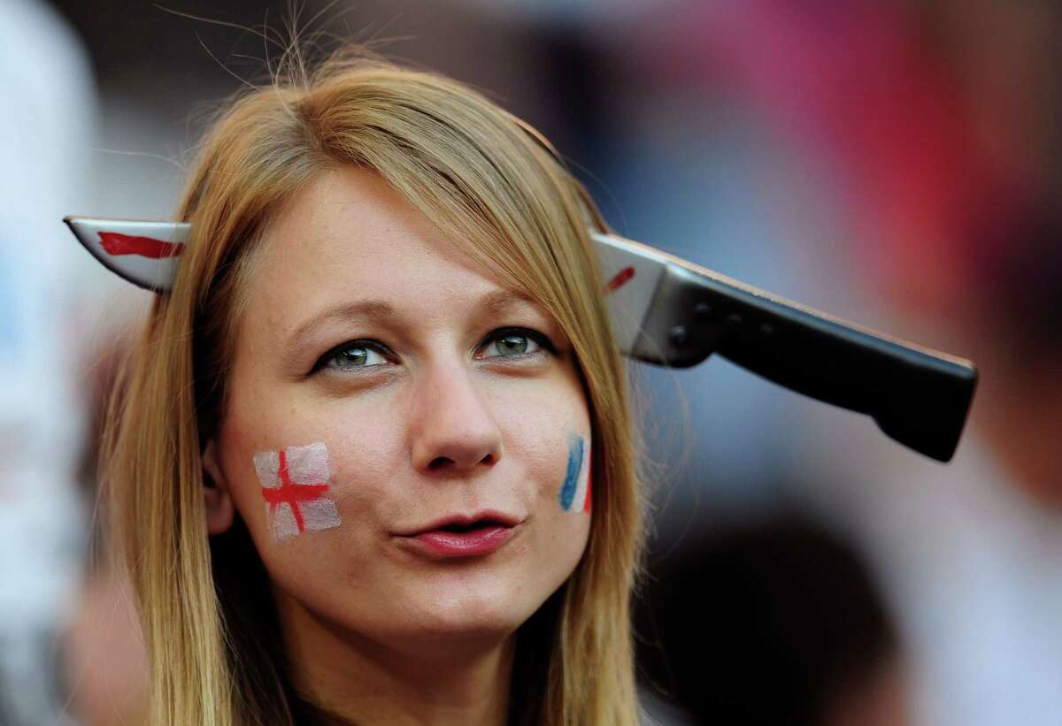 A England supporter waits for the kick-off of the Euro 2012 soccer championship Group D match between France and England in Donetsk, Ukraine, Monday, June 11, 2012. (AP Photo/Manu Fernandez)