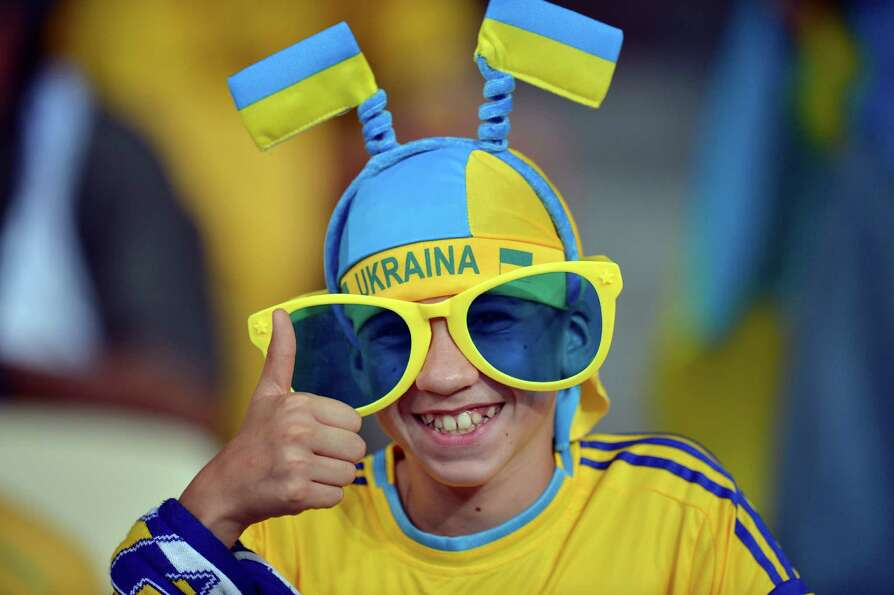 A Ukrainian fan gives a thumb up before the Euro 2012 soccer championship Group D match between Ukra