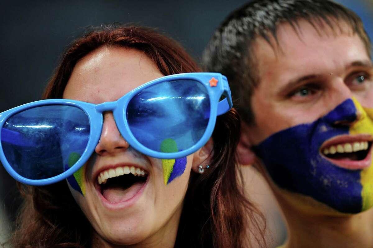 Ukrainian fans cheer prior to the Euro 2012 soccer championship Group D match between Ukraine and France in Donetsk, Ukraine, Friday, June 15, 2012. (AP Photo/Manu Fernandez)