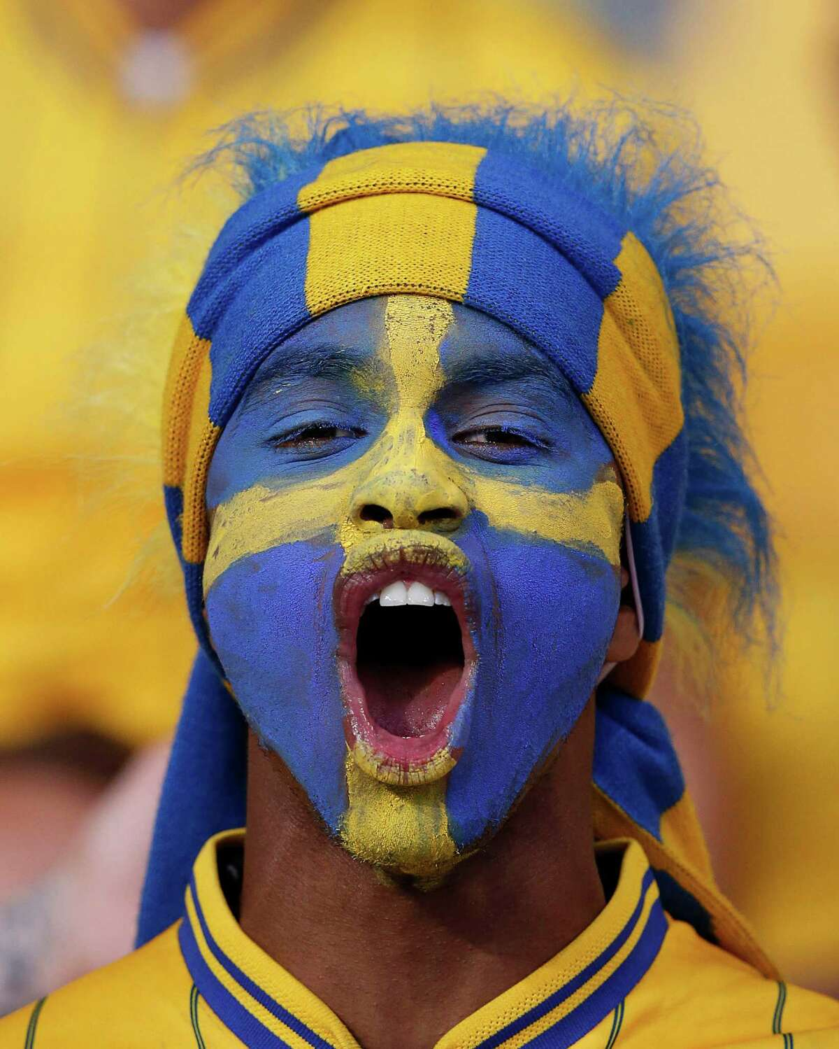 A Swedish fan sings before the Euro 2012 soccer championship Group D match between Sweden and England in Kiev, Ukraine, Friday, June 15, 2012. (AP Photo/Sergei Grits)
