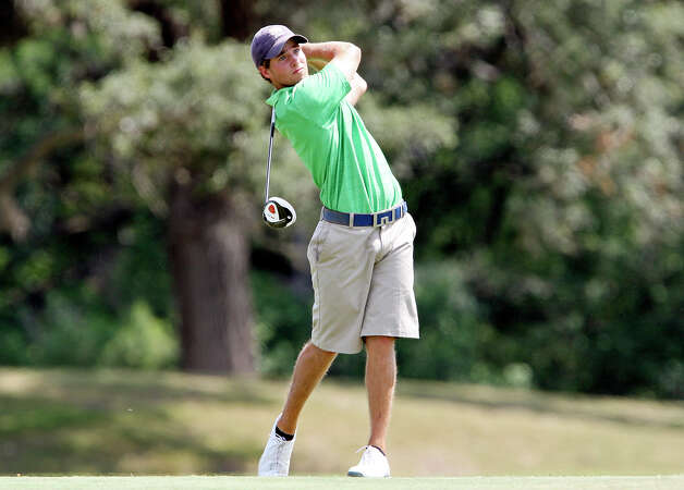 Andrew Carreon watches his tee shot on the ninth hole during the final round of the Greater San Antonio Men's Championship held Sunday June 17, 2012 at The Republic Golf Club.  Adam Lowe defeated Stanton Tondre in a four hole playoff to win the event. Photo: Edward A. Ornelas, Express-News / © 2012 San Antonio Express-News