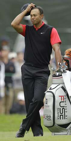 Tiger Woods waits to hit on the sixth hole during the fourth round of the U.S. Open Championship golf tournament Sunday, June 17, 2012, at The Olympic Club in San Francisco. (AP Photo/Ben Margot) Photo: Ben Margot, Associated Press