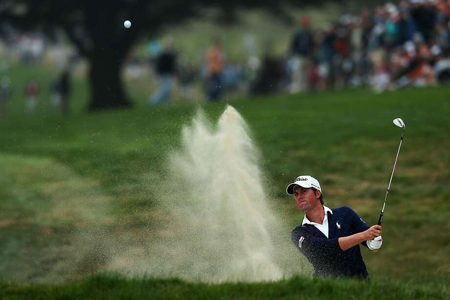 SAN FRANCISCO, CA - JUNE 17: Webb Simpson of the United States plays a bunker shot on the 17th hole during the final round of the 112th U.S. Open at The Olympic Club on June 17, 2012 in San Francisco, California. (Photo by David Cannon/Getty Images) Photo: David Cannon, Getty Images