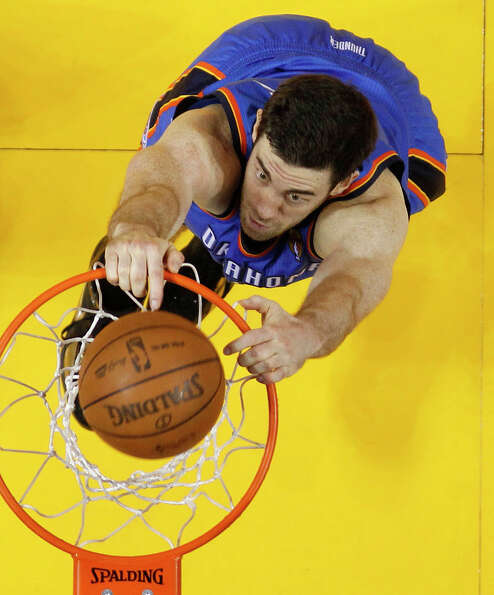 Oklahoma City Thunder power forward Nick Collison (4) dunks against the Miami Heat during the first