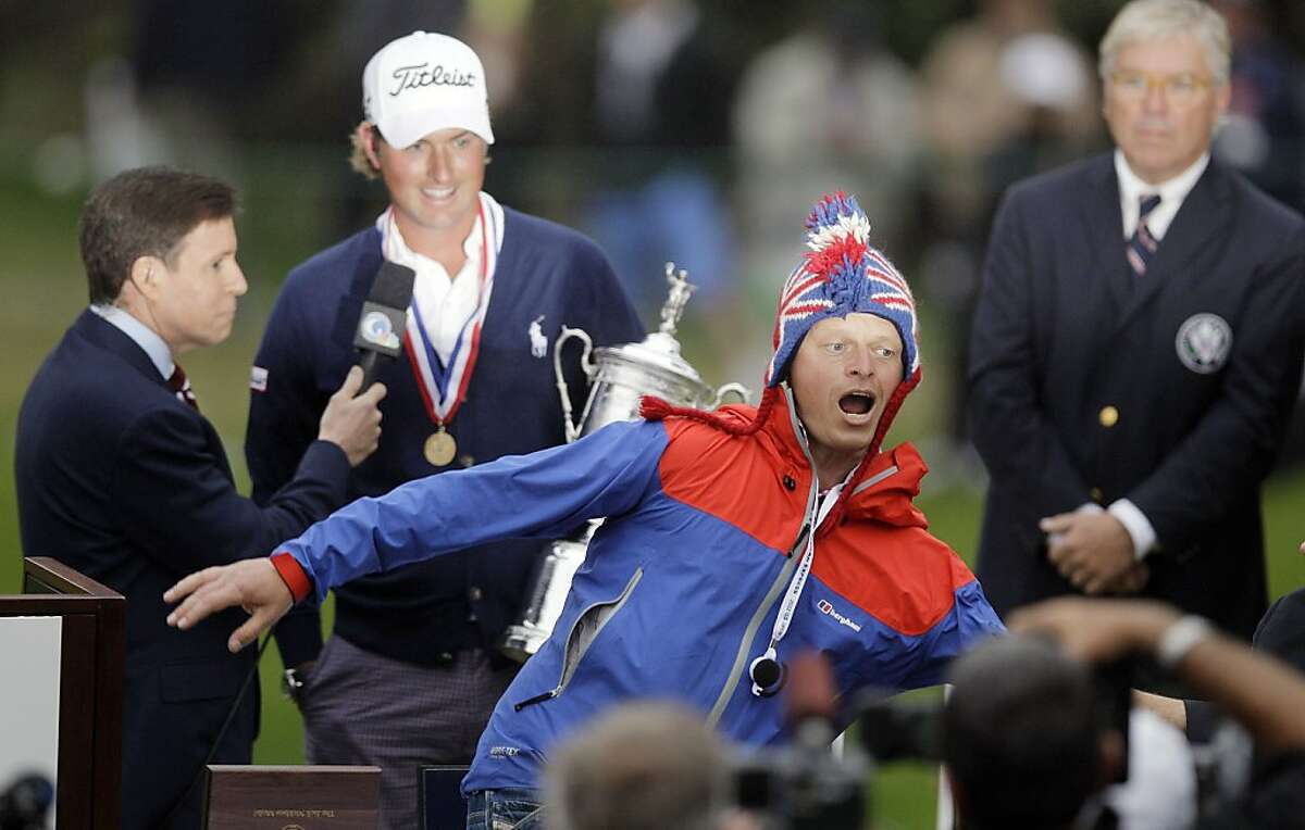 A fans runs in front of Webb Simpson as he is interviewed after the U.S. Open Championship golf tournament Sunday, June 17, 2012, at The Olympic Club in San Francisco. (