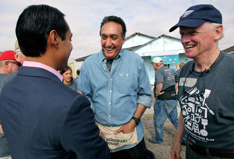 METRO   Mayor Julian Castro greets Henry Cisneros and Frank Keating as The American Bankers Associations teams with local volunteers to build a Habitat for Humanity home for Lorena Magdaleno in the in the Coleman Ridge neighborhood on October 22, 2011.  Tom Reel/Staff Photo: TOM REEL / © 2011 San Antonio Express-News