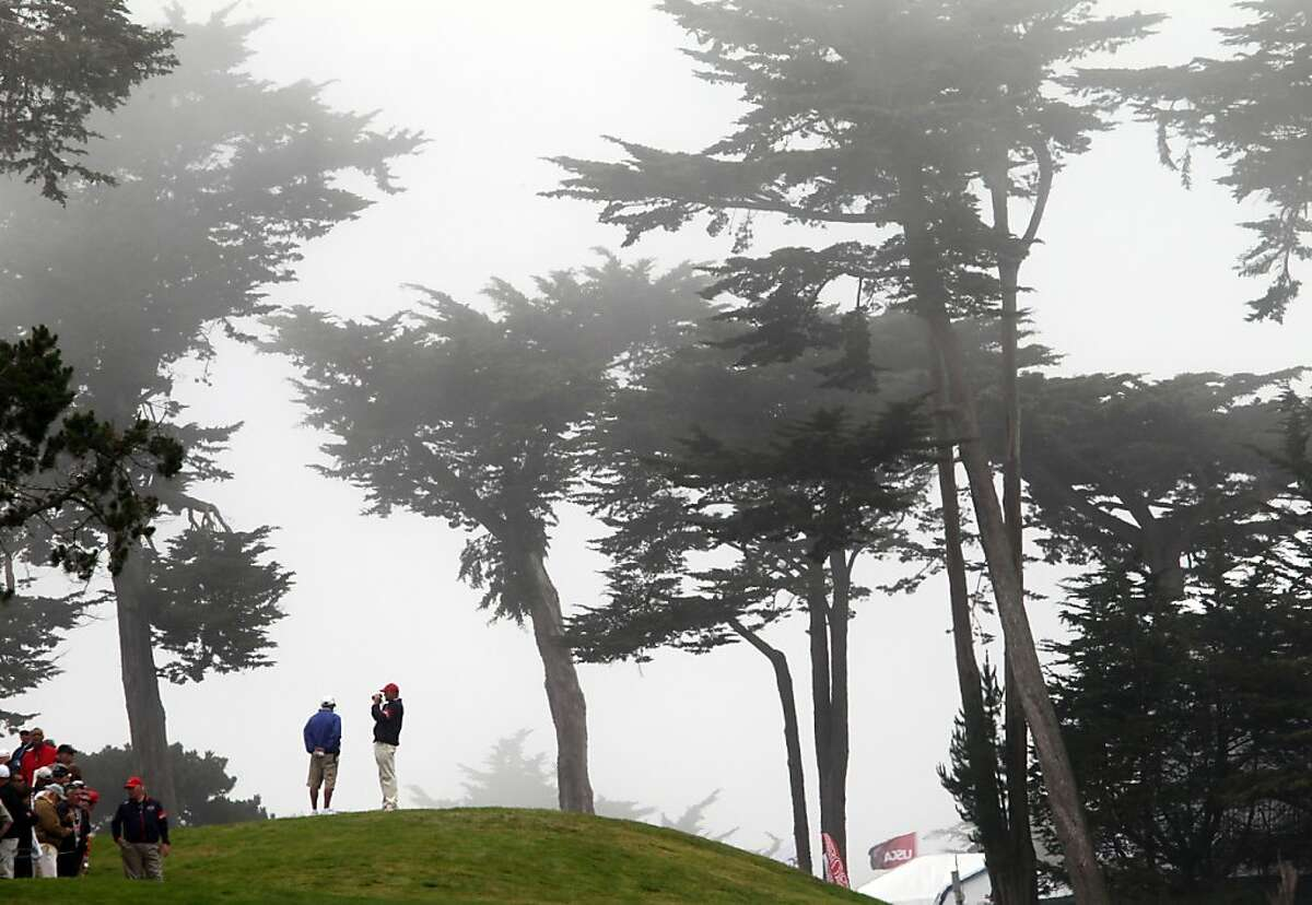 Golfers and the over flow galleries were covered in fog for the final rounds of the 112th U.S. Open trophy that he won at The Olympic Club on Sunday June 17, 2012 in Daly City, California.