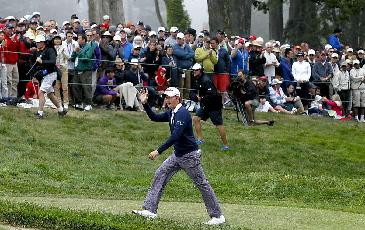 Webb Simpson waves to the crowd as he walks up the final hole, during the final round of the United States Open Championship being played at the Olympic Club in San Francisco, Ca., on Sunday June 17, 2012.