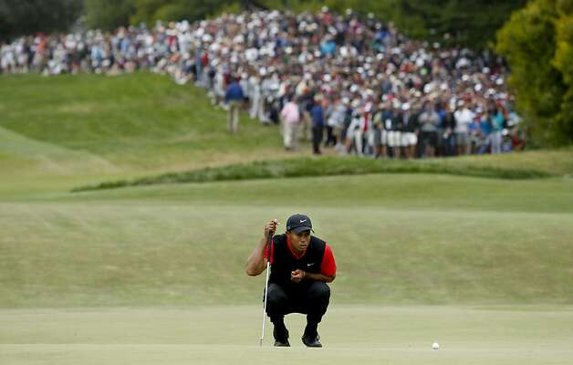 Tiger Woods lines up his putt on the first hole, during the final round of the United States Open Championship being played at the Olympic Club in San Francisco, Ca., on Sunday June 17, 2012. Photo: Michael Macor, The Chronicle