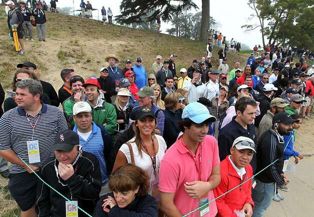 Hundreds of golf fans watch the golfers tee off on the third hole during the final round of the 112th U.S. Open at The Olympic Club on Sunday June 17, 2012 in Daly City, California. Photo: Lance Iversen, The Chronicle