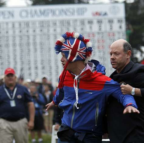 A man is removed from the awards ceremony by USGA officials as he interupted the event, during the final round of the United States Open Championship being played at the Olympic Club in San Francisco, Ca., on Sunday June 17, 2012. Photo: Michael Macor, The Chronicle