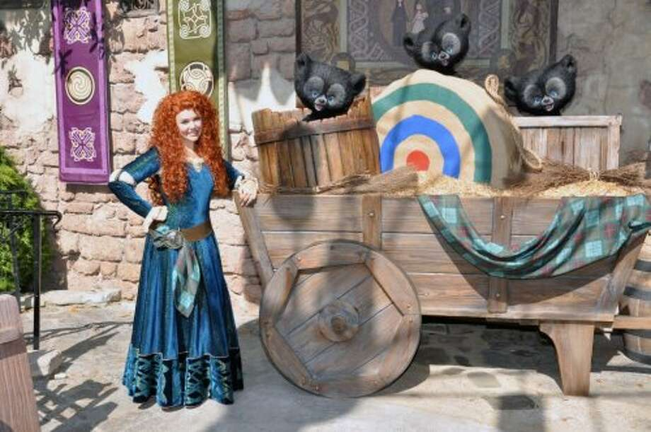 2) MERIDA: Near 'It's A Small World,' fans can take photos with the first-ever heroine in a Pixar film. This adventuresome, spunky Scottish girl with a wild head of curly red hair can tell you a thing or two about archery.  (Disney)
