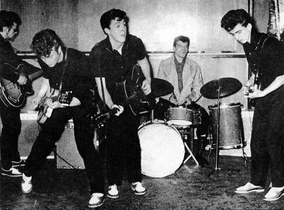 1961?  Very early performance photo, back in the Stu Sutcliffe days. (Michael Ochs Archives)