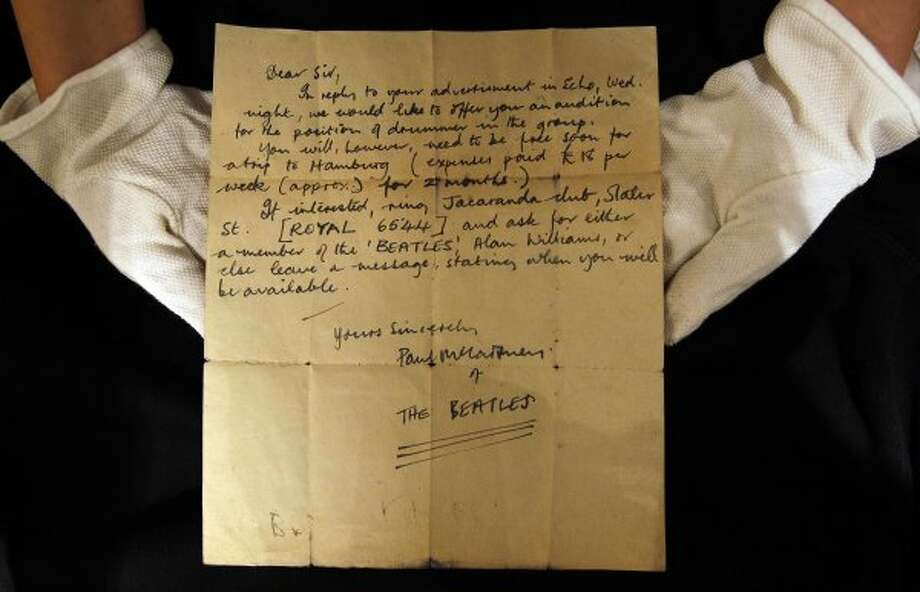 The handwritten letter by Paul McCartney, dated 12 August 1960, inviting an unknown drummer to audition for The Beatles, was discovered folded-up inside a book, by an anonymous collector at a car boot sale in Bootle, Liverpool, England.   It shows he was a professional even then. (Kirsty Wigglesworth / Associated Press)