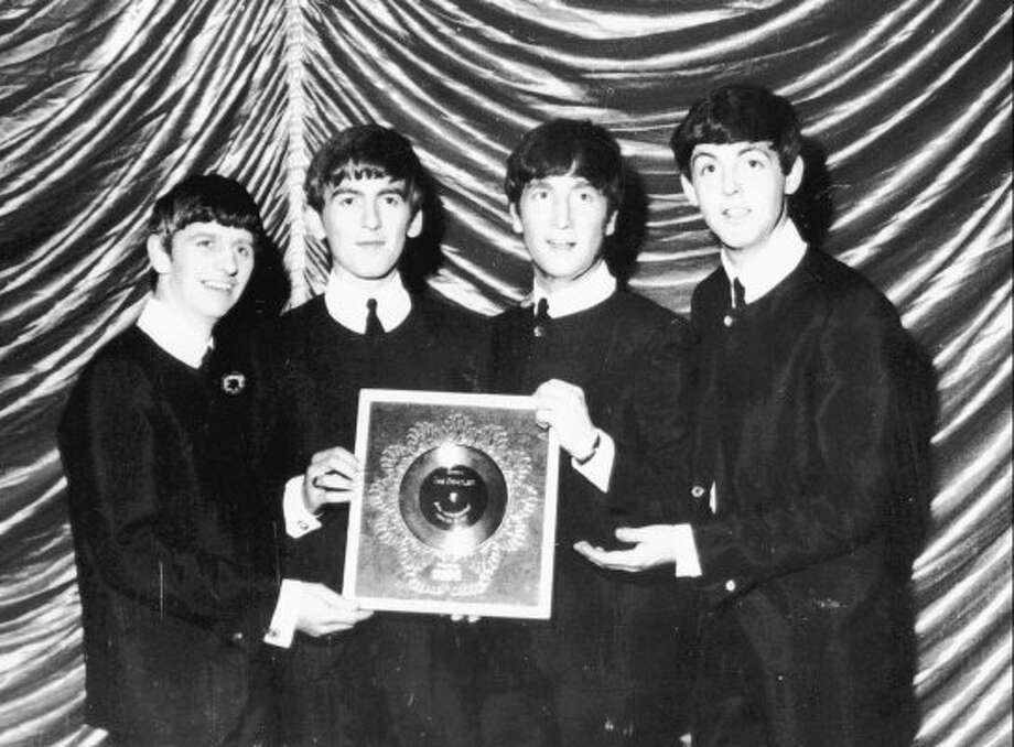 1964 -- or maybe earlier.  The Beatles celebrating an early milestone. (DEZO HOFFMAN / ABC)