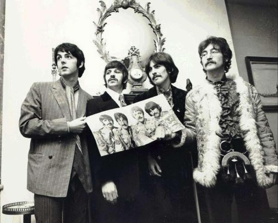 1967 -- showing off their new album.   (APPLE CORPS LTD. / ABC)