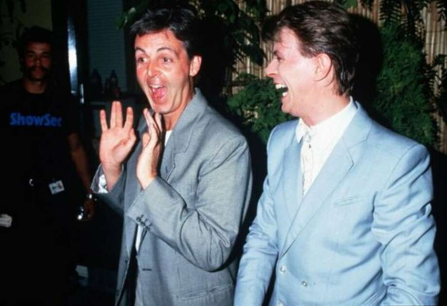 1985:  Being Paul McCartney means EVERYBODY laughs at your jokes, even David Bowie.  Here he's at Live-Aid.