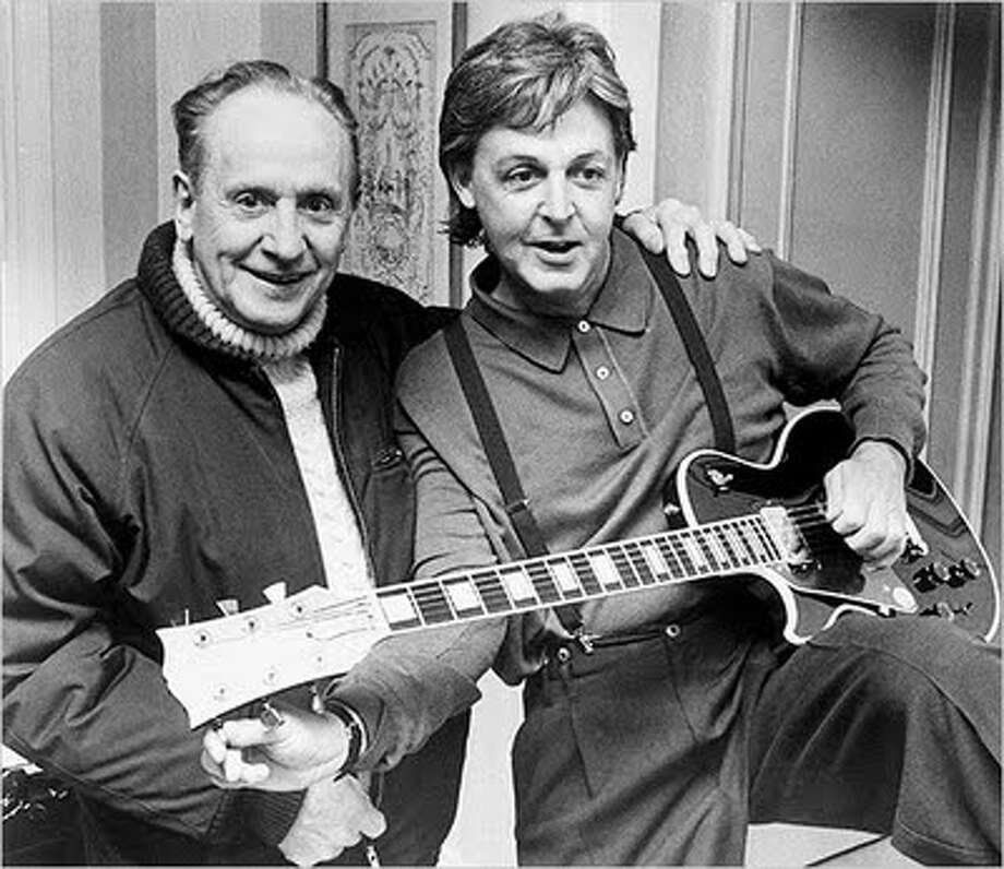 Paul and Les Paul in 1988.
