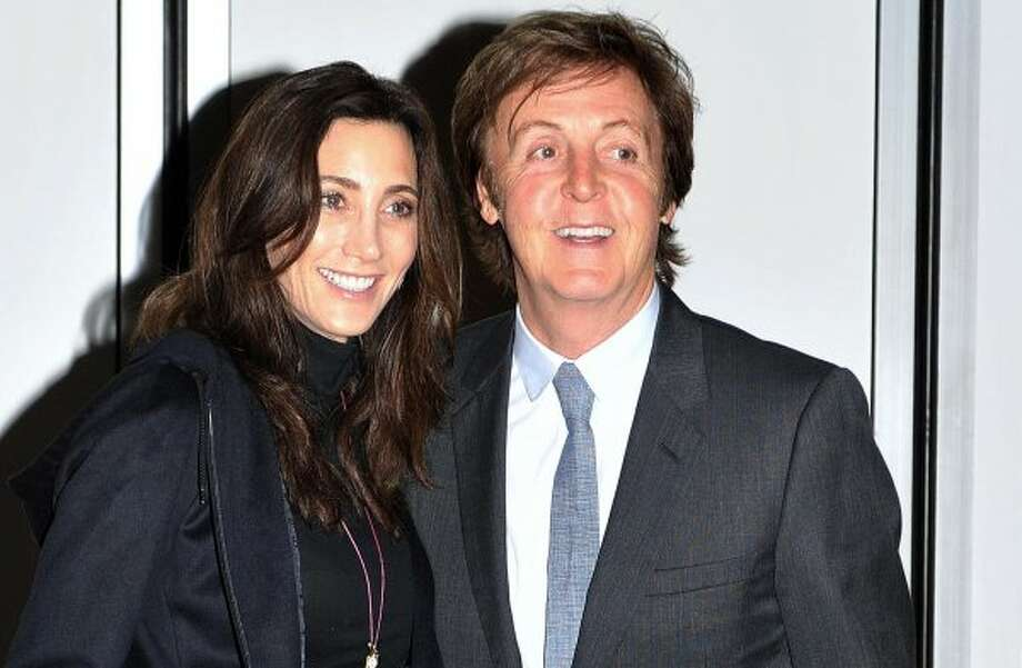 Paul McCartney, right, and his fiance Nancy Shevell pose for photographers outside their home in north London, Saturday, Oct. 8, 2011. The day before their wedding. (John Stillwell / Associated Press)