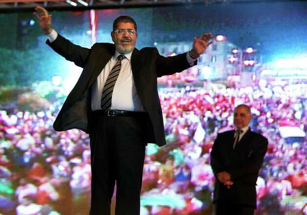 FILE - In this Sunday, May 20, 2012 file photo, the Muslim Brotherhood's presidential candidate Mohammed Morsi holds a rally in Cairo, Egypt. The Muslim Brotherhood has declared that its candidate, Mohammed Morsi, won Egypt's presidential election, early Monday, June 18, 2012.(AP Photo/Fredrik Persson, File) Photo: Fredrik Persson