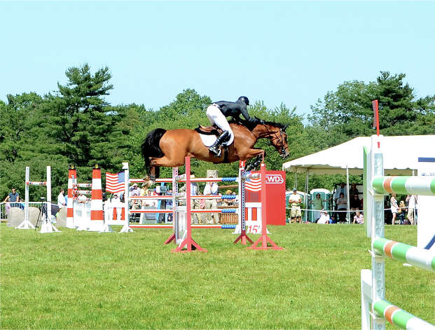 "Geoff Chase rides ""Sil"" at the 82nd annual Ox Ridge Charity Horse Show June 17, 2012, in Darien, Conn. Photo by Jeanna Petersen Shepard Photo: Contributed Photo"