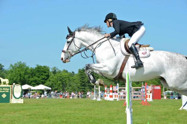 "Jackie McQuade rides ""Copilot"" at the 82nd annual Ox Ridge Charity Horse Show June 17, 2012, in Darien, Conn. She placed eighth in the grand prix. Photo by Jeanna Petersen Shepard Photo: Contributed Photo"