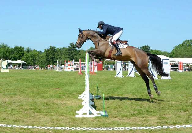 Paul OíShea rides ìWizzî at the 82nd annual Ox Ridge Charity Horse Show June 17, 2012, in Darien, Conn. He placed fourth in the grand prix. Photo by Jeanna Petersen Shepard Photo: Contributed Photo